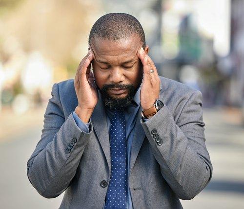 person with barometric pressure headache