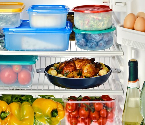 open refrigerator with foods organized for weight loss