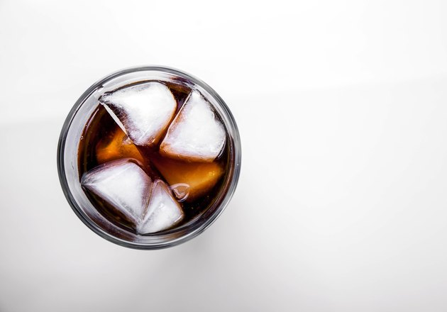 soft drinks. Cola glass with ice cubes on white background
