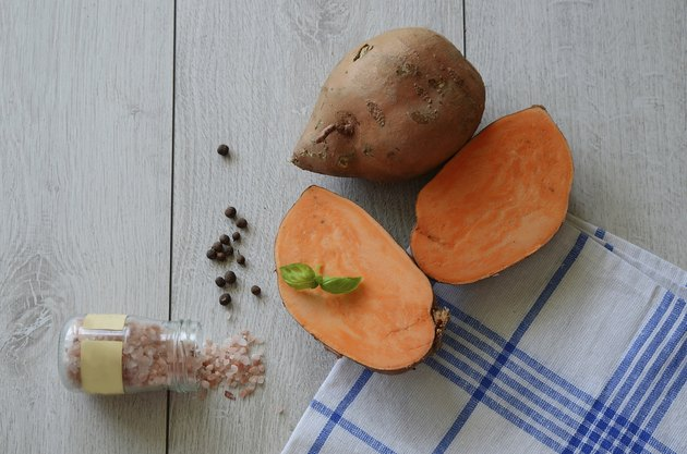 Raw sweet potato cut with spices