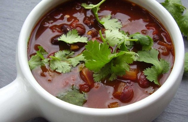 Close overhead view of a cup of spicy vegetarian chili