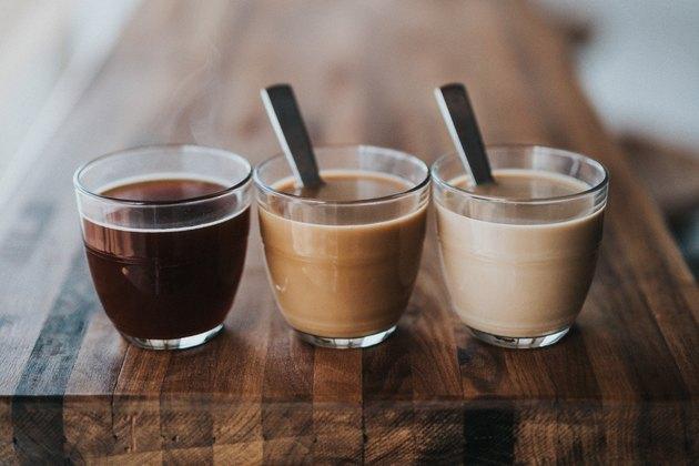Coffee cups on a wood bar