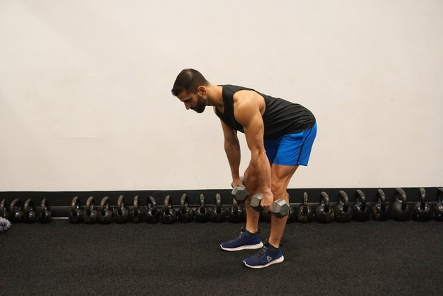 Man demonstrating how to do dumbbell romanian deadlifts