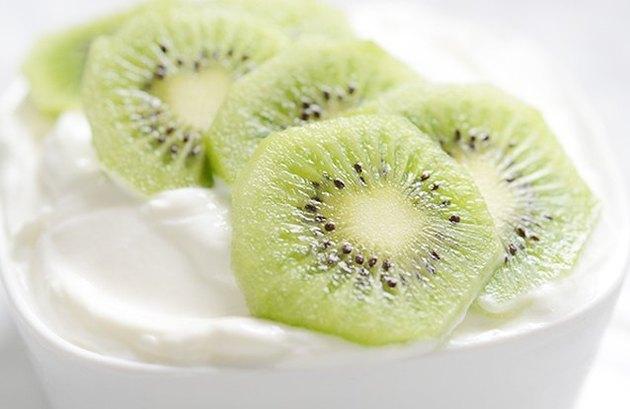 Bowl of yogurt topped with kiwi slices