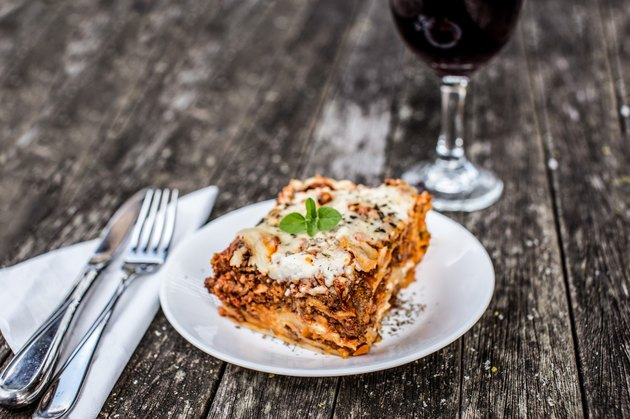 baked lasagna with cheese and fresh basil