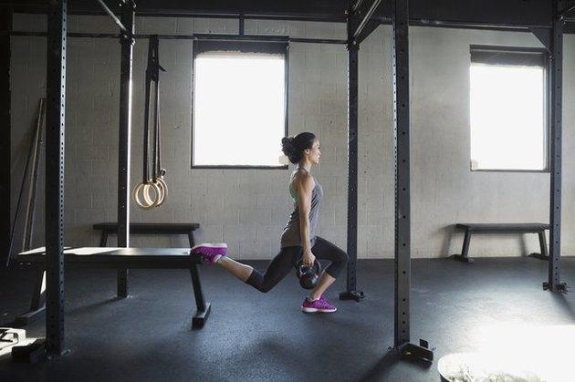 Woman performing Bulgarian split squat.