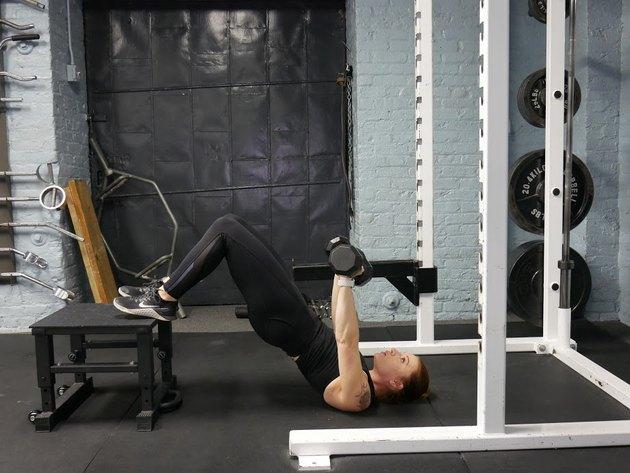 Proper form for heel-elevated hip thrust decline.