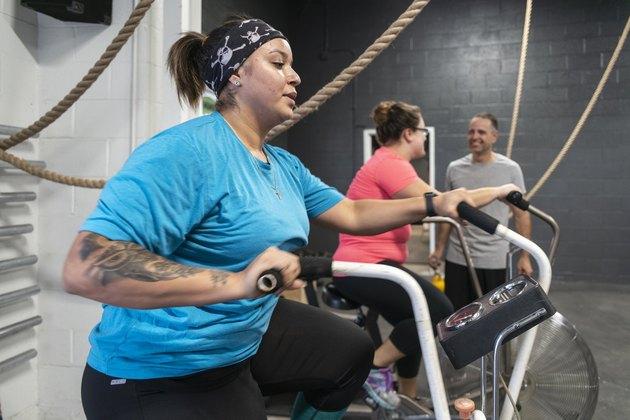 Woman on an air bike doing a beginner gym workout