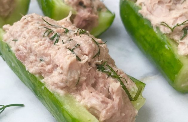 Close view of tuna salad in a hollowed-out cucumber