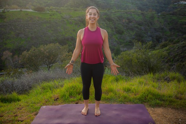 Woman standing in mountain pose on yoga mat