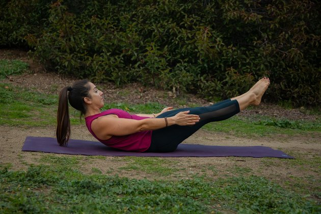 Woman performing core exercise.