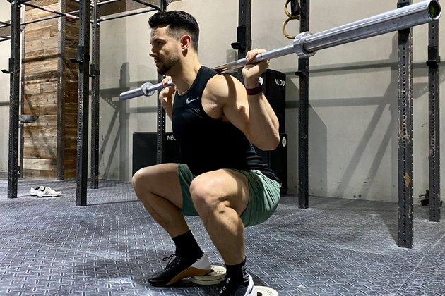 Mathew Forzaglia performing heel elevated squat.