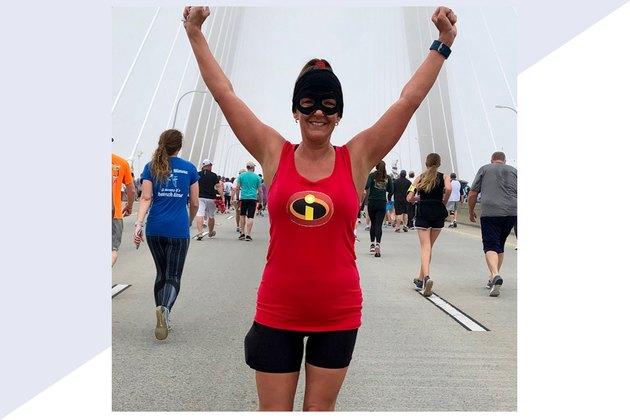 Maranda Boiter running a race after postpartum weight loss