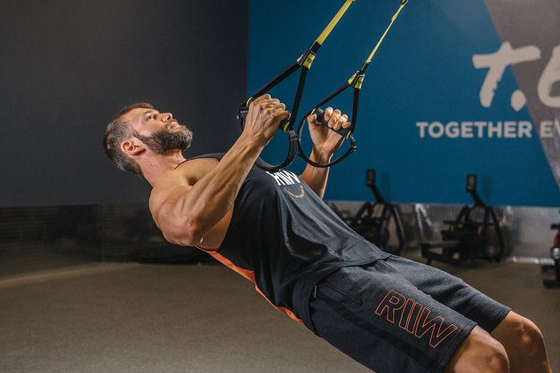 Man demonstrating how to do TRX Inverted Rows