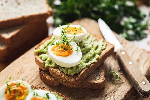 healthy breakfast recipe of hard-boiled egg on avocado toast