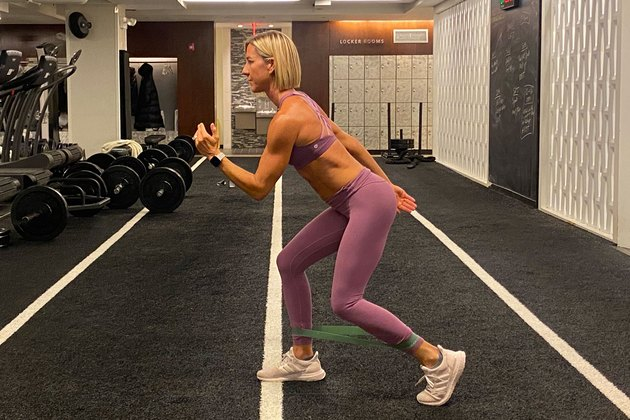 fitness instructor kira stokes demonstrates the tap back glute exercise with a resistance band