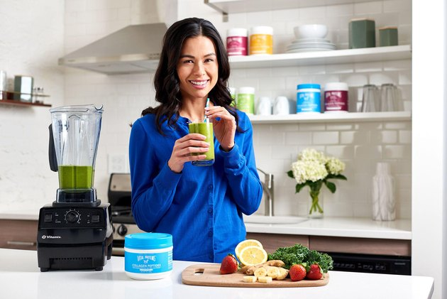 woman making smoothie with Vital Proteins Collagen Supplement