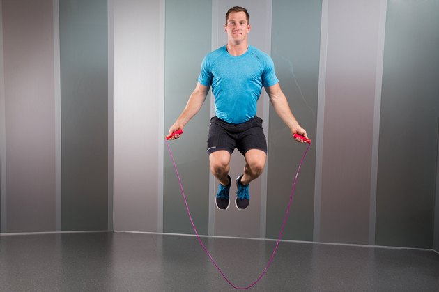 Man Demonstrating How to Do High-Knee Jumps