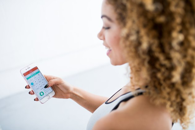 woman using livestrong.com myplate app