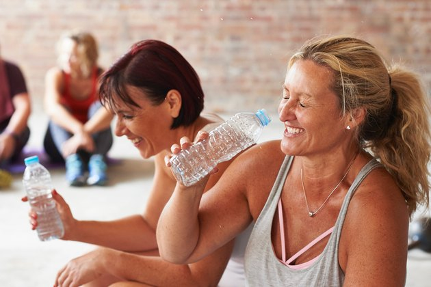 two middle-aged women laughing after cardio workout