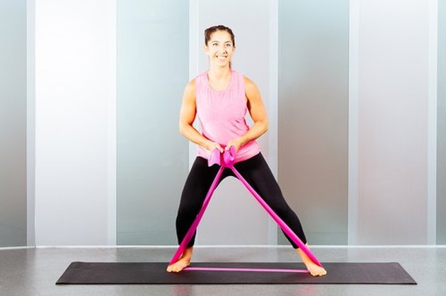 Proper form for the resistance band side step exercise.