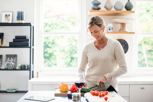 Woman in her 40s preparing low-carb dinner in her kitchen
