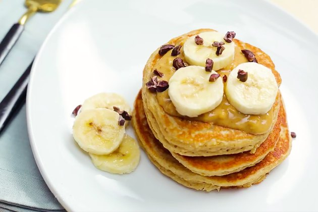 stacked pancakes with bananas