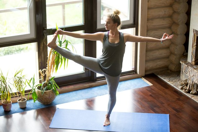 Woman doing Extended Hand-to-Big-Toe Pose standing yoga pose for balance