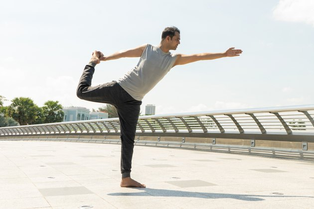 Man doing Lord of the Dance standing yoga pose for balance
