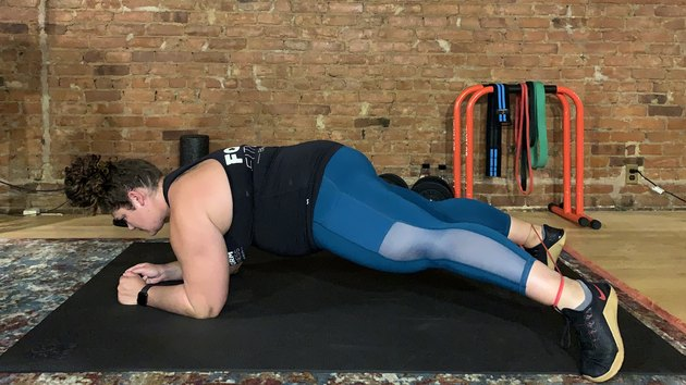 Move 6: Plank With Toe Taps