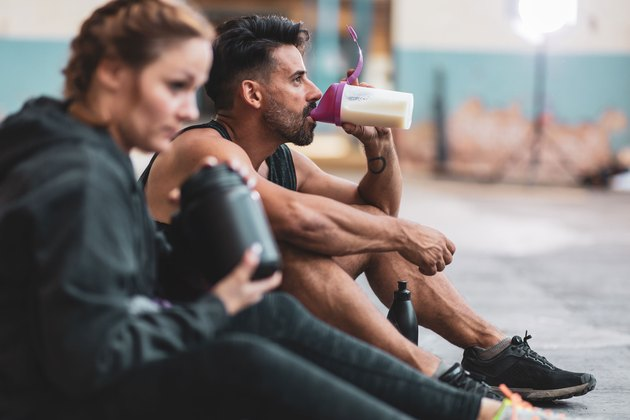 Athletes drinking amino acid supplements