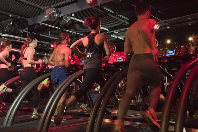 People running on the treadmill during a Barry's Bootcamp workout