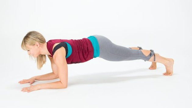 Elise Joan demonstrates how to do a Forearm Plank