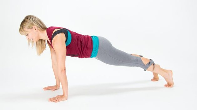 Elise Joan demonstrates how to do a Straight-Arm Plank