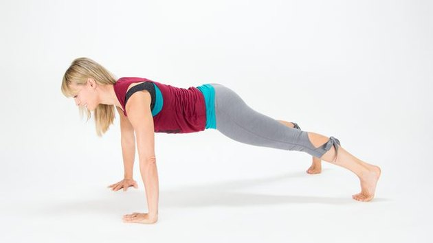 Elise Joan demonstrates how to do a Wide-Arm Plank