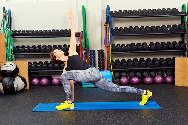 Woman demonstrating how to do a high-lunge with core rotation