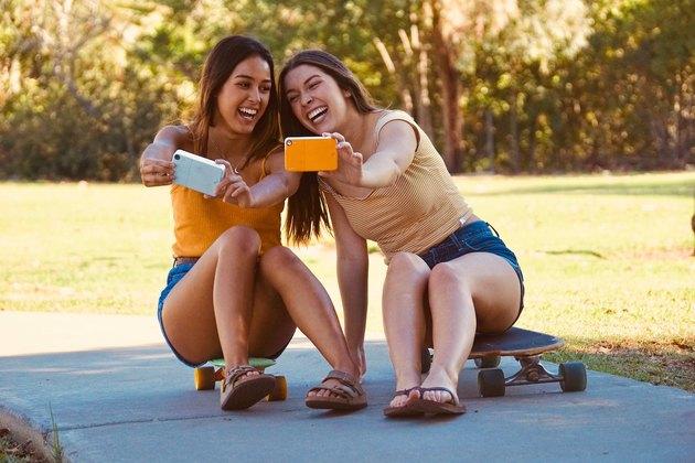 girls taking selfies