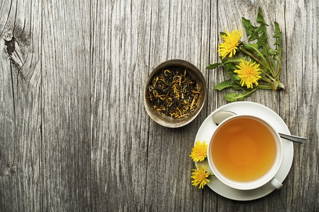 cup of dandelion tea on a wooden table