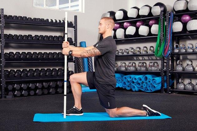 6. Half-Kneeling Quad Stretch With Stick