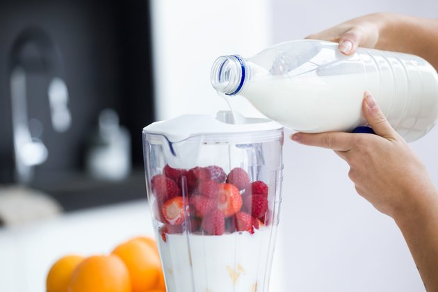 Dairy free lactose free milk pouring into blender for smoothie