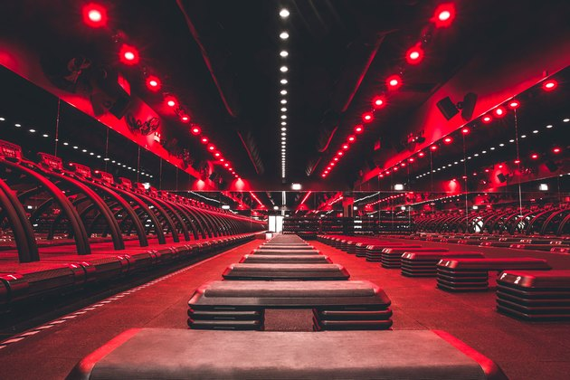 Treadmills and strength training stations at a Barry's Bootcamp workout class