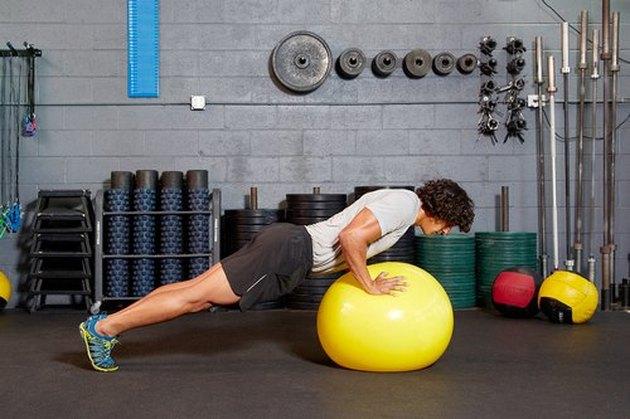 37. Swiss-Ball Push-Up (Feet on Floor)