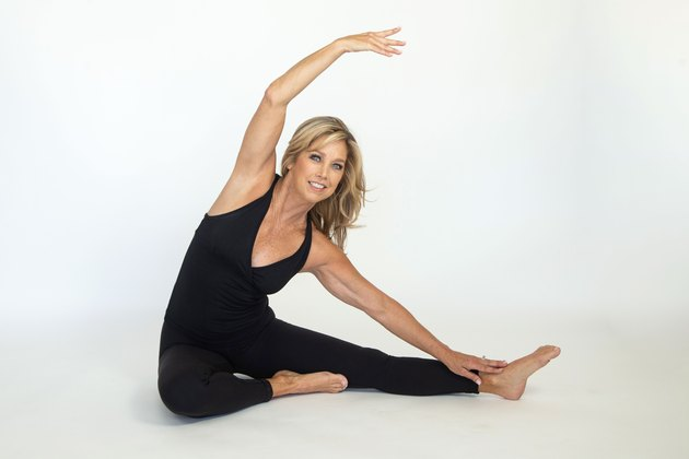 Denise Austin performing side body stretch.