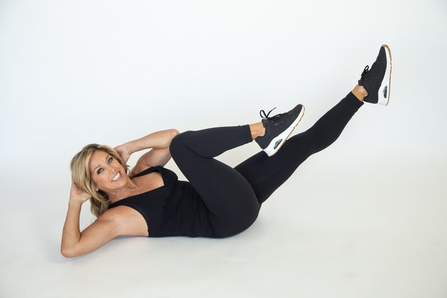Denise Austin performing bicycle exercise.
