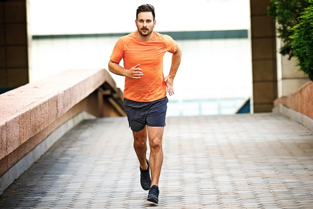 Man running outside as part of his 10K training