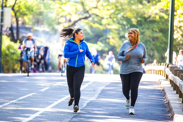 Two younger women jogging outdoors