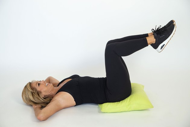 Denise Austin performing lower tummy tightener exercise.