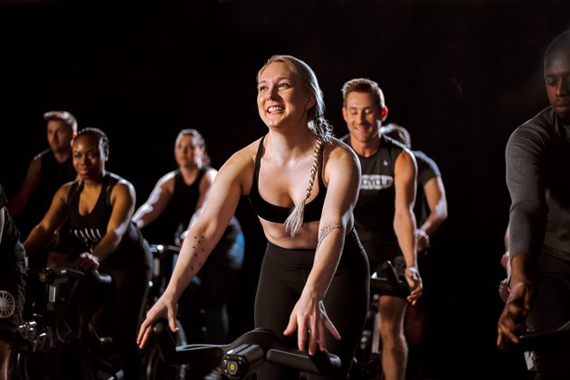Riders in a SoulCycle workout class.