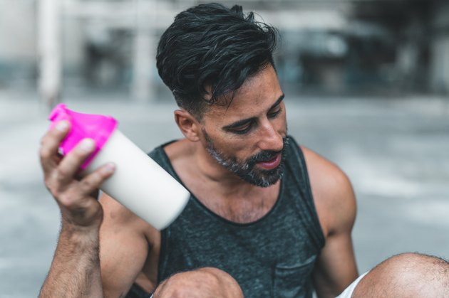Man with sports nutrition protein shake