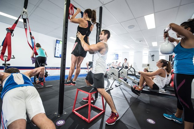 group of men and women in an F45 class working out